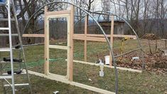 Old trampoline frame into greenhouse or chicken coop
