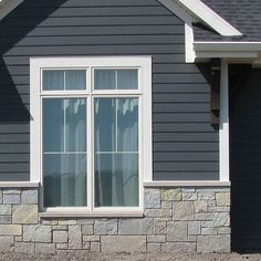 Buff Gray Castle Rock matches perfectly with the blue-gray siding and white trim on this home. Does natural stone enhance the appearance of… Stone Exterior Houses, Grey Exterior, House Paint Exterior, Exterior Siding, Exterior House Colors, Stone Houses, Gray Siding, White Siding, Stone Veneer Siding