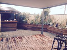 Alfresco, bar & planter boxes. Timber: spotted gum   Cracker dust down all ready for artificial lawn!