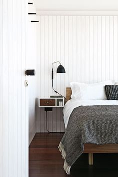 Modern country bedroom with shiplap walls. Photo by Damian Russel via Inside Out