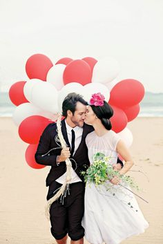 Add a playful touch to your wedding pics with balloons.