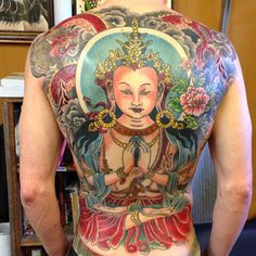 Avalokiteshvara backpiece from a couple of years ago by @scottellistattoo .