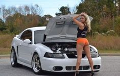 For decades, a sales technique at auto shows employs female models attired in tight dresses or miniskirts wearing uncomfortable heels, smiling and posing enchantingly. Mustang Girl, Ford Mustang, Trucks And Girls, Car Girls, Sexy Cars, Hot Cars, Carros Vw, Modified Cars, American Muscle Cars