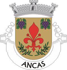 """ANADIA - Por: Graça Pintado: ANCAS - Brasão, Bandeira e Selo - Armas - Escudo de ouro, flor-de-lis de púrpura, acompanhada em chefe de dois cachos de uvas do mesmo, folhados de verde e, em ponta, de dois ramos de oliveira de verde, frutados de negro. Coroa mural de prata de três torres. Listel branco, com a legenda a negro: """" ANCAS """"."""