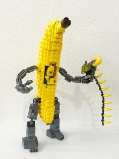 Lego Man in Banana Suit piloting Banana Mecha shooting bananas for scale - Lego…