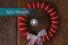 Craft your own Christmas wreath using yarn and an oh-so-cute bow. It's easier than you think! Find more pretty Christmas wreaths here: http://www.bhg.com/christmas/wreaths/pretty-christmas-wreaths/?socsrc=bhgpin120514sparklingsilverwreath&page=15