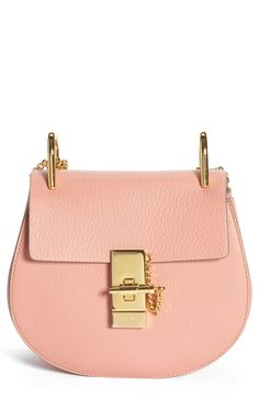 Crushing on this cute pink and gold Chloe crossbody bag.