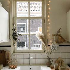 Simple white kitchen . Earthy kitchen