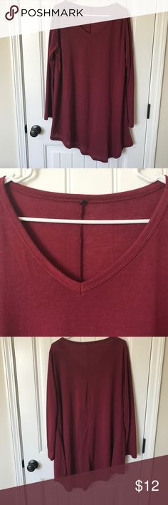 Asymmetrical long sleeved tunic NWOT Asymmetrical v neck long sleeved tunic  Measurements(inches): Length 36, Chest 25 across Tops Tunics