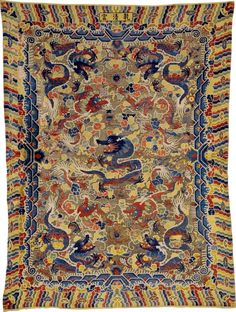 A silk and metal thread 'Nine Dragon' Chinese carpet, China, Qing dynasty, late 19th century, or possibly