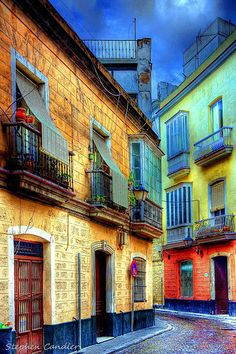 These buildings in Cadiz(Spain) are so colourful that it looks like a painting.  #MediumMaria