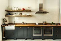 dark green cabinets + butcher block countertop (Notting Hill - Compass & Rose)