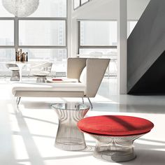 Platner Side Table and bright red ottoman.