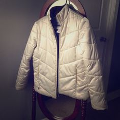 White puffer coat, also on ♏️ercari Awesome coat! I just have too many. It also has an inside pocket. The sleeves have elastic inside bands at the wrists, which are stretched. Unless you're playing in the snow you won't notice. This coat is wonderful. Jackets & Coats Puffers