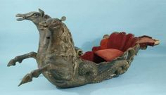 18th Century Russian wood carved snow sleigh in the form of two sea horses pulling a sea shell.