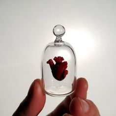 Kiva Ford blows glass into tiny exquisite things, including this heart in a jar and Klein bottle earrings.