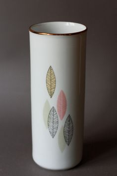 Mid Century Modern Porcelain Vase with Leaves Decals by Winterling 1940s. €48,00, via Etsy.