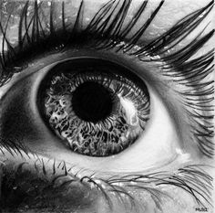 Hyperrealistic pencil drawings of eyes up close