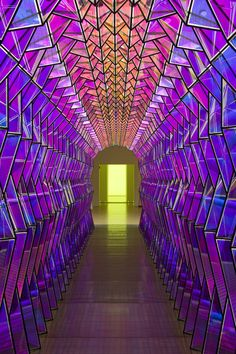 "An old exhibit at MOMA titled ""Take Your Time: Olafur Eliasson. A geometric, purple jewel toned hallway."