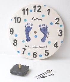 DIY painted clock face with baby footprints.