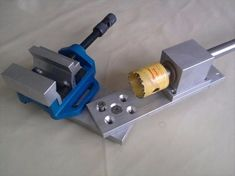 Tube Notcher by valy -- Homemade tube notcher constructed from steel stock, bushings, shafting, and a hole saw. http://www.homemadetools.net/homemade-tube-notcher-10