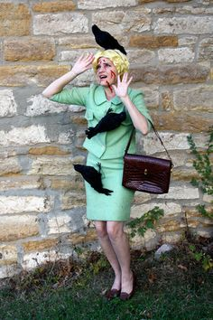 I love this Halloween costume!!! Hitchcock would love it! If you don't recognize it, it's from one of the best scenes ever, Tippi Hedren being attacked by flocks of birds in The Birds