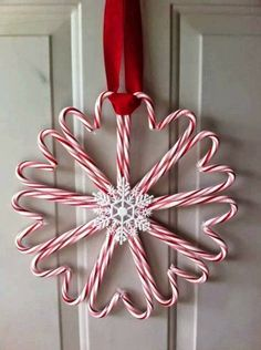 Candy Cane Wreath....You can buy plastic ones at dollar tree and use a glue gun to put it together! Diy Christmas Decorations Easy, Christmas Party Games, Diy Christmas Ornaments, Outdoor Decorations, Christmas Wreaths, Christmas Ideas, Candy Cane Wreath, Candy Canes, Diy Ideas