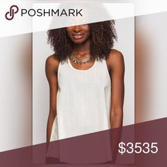 Cream Faux Leather Mesh Tank Top Add a little edge to any look! This faux leather tank can be worn with jeans, under a blazer, with a skirt, so many possibilities. The perforated top is made of 60% cotton /40% polyester and has a racer back. It is also available in black. The NEW Boutique Tops Tank Tops