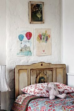 The decor embraces that wonderful vintage charm and the spontaneity of eclectic whimsy. This rustic antique headboard is so pretty with the colorful quilted bedding.