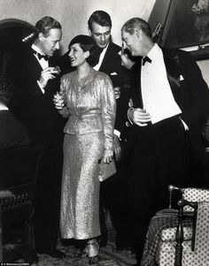 Leslie Howard, Norma Shearer, Gary Cooper and Lionel Barrymore at Gary Cooper's Christmas Eve Party, 1934.
