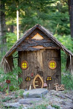 There are several fairy houses, ranging from 12-inch-tall structures to even tinier facades built into tree trunks. The lights inside shine at night.