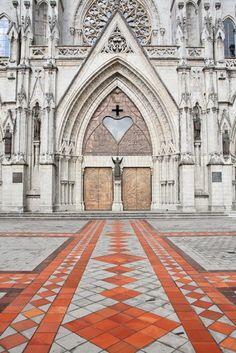 The grand entrance to the Basilica del Voto Nacional in Quito, Ecuador