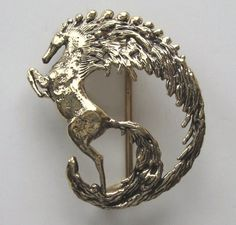 Large horse brass buckle by Carl Tasha, well known Cape Cod artist. Your Pampered Horse has many of his buckles on sale. See them all on our website.
