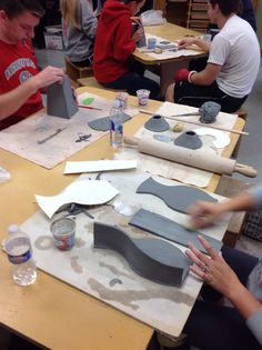 Ceramic 1 - template construction. LIn the background, left handed & wounded F.H. observes his classmate's progress.