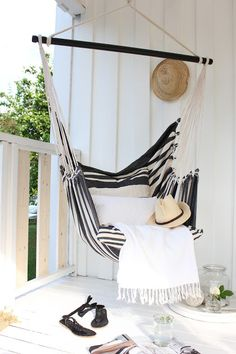 someone PLEASE help me find this exact hammock in the US! All white painted wood. Black and white stripes hanging porch hammock. Summer living, how to make a small space stylish. Outdoor Spaces, Outdoor Living, Outdoor Decor, Outdoor Kitchens, Balcony Swing, Porch Swing, Balcony Chairs, Balcony Furniture, Outdoor Balcony