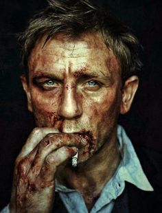 bloody cool! Daniel Craig, still hot even when messed up!