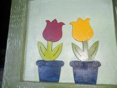 Quadro infantil com tulipas.