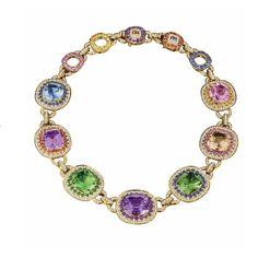 The exquisite statement that is The Tutti Fruitti collier resplendent with green amethyst, amethyst, topaz, Rose de France surrounded by a myriad of sapphires, garnets, amethysts and diamonds from the Margot McKinney 2014 collection by Margot McKinney