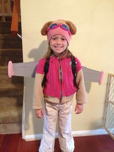 Paw Patrol Skye costume. Painted Buzz Light Year wings, winter hat, pink swim goggles & puppy ears from the dollar store!