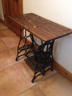 Antique sewing machine as entryway table.  Replaced marble top with wood.  1 board cut into thirds, glued together, sanded, stained and sealed.