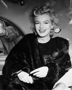 "In this June 2, unknown year, file photo, actress Marilyn Monroe smiles in a car after arriving tousled from an all-night plane flight from Hollywood to Idlewild Airport, in New York. She said she planned to rest in New York before going to England to make a new movie with Sir Laurence Olivier. Sidestepping questions as to whether she and playwright Arthur Miller plan to wed, she said: ""No comment, we're really good friends."" Photo: Associated Press / AP"
