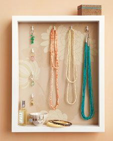 Some baubles are just too pretty to put away at the end of the day. But with a jewelry holder and display case made from a basic shadow box, you'll have less clutter, more chances to admire your favorite pieces, and everything within reach.    All you need to add to the inside of the box are hooks; the hardware for hanging the box is already mounted on the back. Learn how via Martha Stewart.