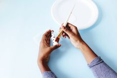 Paint + glaze oven bake clay to make a cute cone just for organizing your rings.