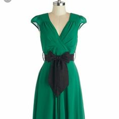 Have the Dance Floor modcloth dress in Emerald An emerald green dress, perfect for bridesmaids/formals! Size L, fits roughly a 10-12. Knee length. Black sash available. Never worn, tags still on. ModCloth Dresses
