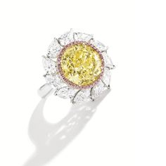 Round Vivid Yellow Diamond Ring. GIA certified weighing 6.84 carats and has a vvs2 clarity grading. A very unique yellow diamond estimated at $300K-$500K. For sale at Sotheby's. Learn more: http://www.naturallycolored.com/blog/sothebys-is-painted-in-pink-with-a-world-record-candidate/