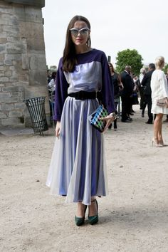 Très Chic! The Best Street Snaps at Paris Fashion Week: Feeling a little equestrian inspired.  : Every girl needs a great slouchy sweater like this in her closet for Fall.  : Elena Perminova is a print all-star.  : Floral dresses were made for wearing with bomber jackets, didn't you know? : Menswear with a bold accessory twist.  : Coordinating cat-eye shades.
