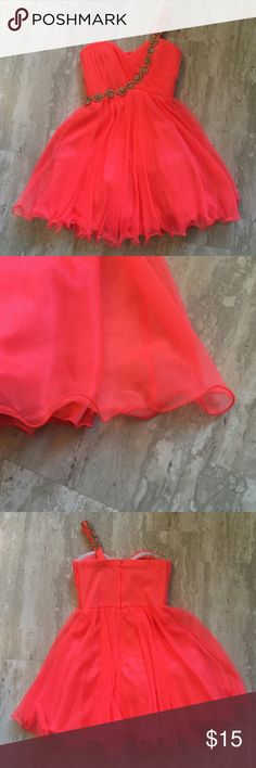 Coral One Shoulder Homecoming Dress Tulle under skirt. Not missing any of the beading. Strap has been shorted but could be let out with a seam ripper. Some of the curliness of the hem has come on one side (pictured) but you can still wear it like that, I did. My Michelle Dresses Prom