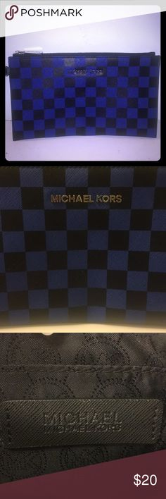 Michael Kors➖Blue and Black➖Checkered Wristlet This checkered leather wristlet is in mint condition. It pairs perfectly with an all black outfit for a pop of color or it can be paired casually with a pair of jeans and a white tee. Either way you will look fabulous!!! Michael Kors Bags Clutches & Wristlets