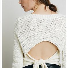 "⭐️HP NWT Free People Bow Backed Pullover Size M NEW WITH TAGS -- Cropped to the natural waist, this ivory chunky knit pullover features an open back with a contrast adjustable tie. Wear it with a contrasting cami or bare backed if you dare! Ribbed detailing around the waist, neck and cuffs. 25"" length, 100% cotton body with cotton / nylon trim. Still on Free People's website for full price $98. ⭐️Style Obsessions Host Pick Free People Sweaters"