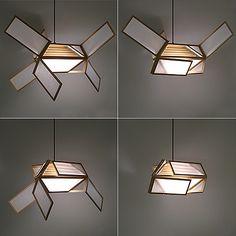 """Kisa Kawakami designs the transforming Kisawings lamp for Yamagiwa."""